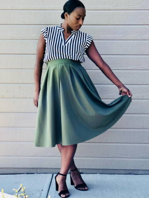 """Promising review: """"I ordered this skirt in olive and navy in size XL. I'm normally about a size 14–16, and both skirts fit perfectly. I'm about 5'2"""", and the skirts hit about mid-calf on me. They're cute. I wear them to work and get compliments throughout the day. No one believes I bought them off of Amazon! The skirt has a slip layer underneath as well that I like and pockets!! The pockets are a great size, I can comfortably fit an iPhone 7 Plus in them without worrying about it falling out. The material is nice quality, not see-through at all, and has a good weight to it. The zipper gets stuck a little, but that's just invisible zippers for you. I'm able to just wiggle it on though, no problem. Very comfy to wear in the summer when it's hot and humid! Will be buying more!"""" —BaileeGet it from Amazon for $18.98+ (available in sizes S–XL and 14 colors)."""