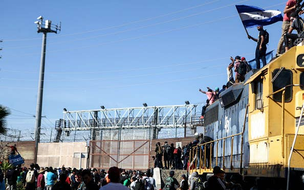 Migrants who tried to breach the US border on Sunday were stopped by this border barrier.