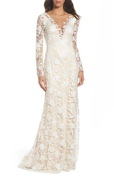 62a7b6e69 A lace A-line sheath dress that will assure you everything will be coming  up roses on your wedding day.