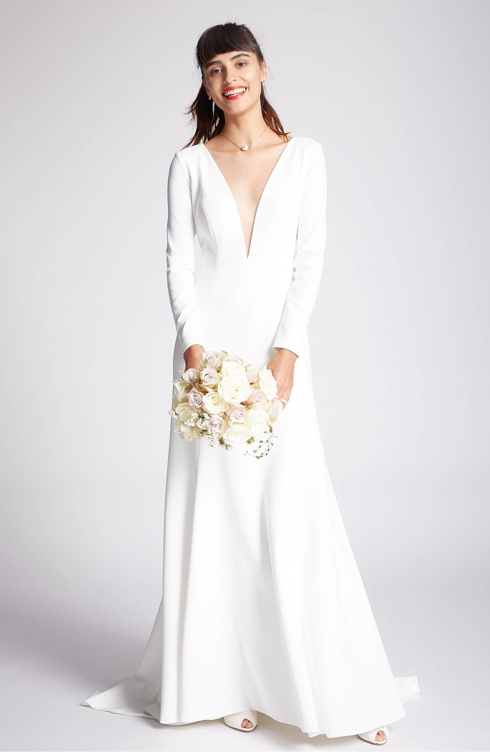A wedding dress with a plunging neckline and a trendy cutout in the back  that will make your grandma blush — but she can t complain because IT HAS  SLEEVES! b5004397c