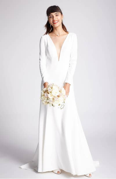 a37d29219 A wedding dress with a plunging neckline and a trendy cutout in the back  that will make your grandma blush — but she can't complain because IT HAS  SLEEVES!