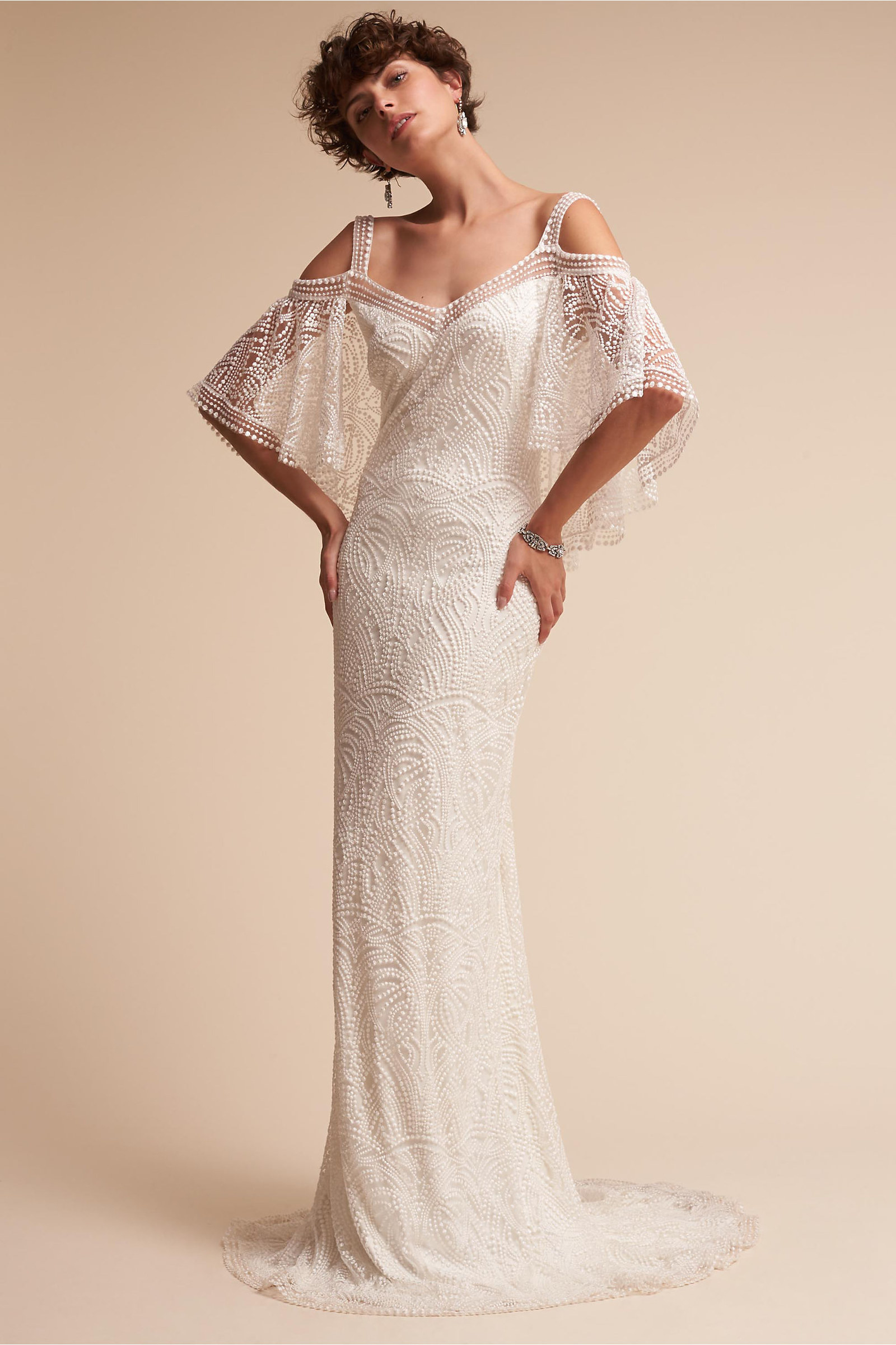 A fluttery bohemian gown for the flower child who wants to seamlessly float  down the aisle without sacrificing her own personal style. 3aa21635d