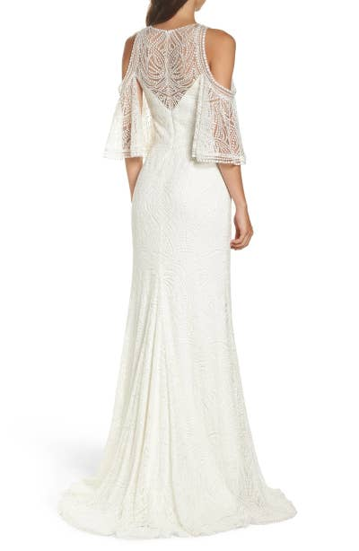 166473bd1 A dazzling cold-shoulder wedding gown that will keep the couple so  distracted they won't even think about getting cold feet.