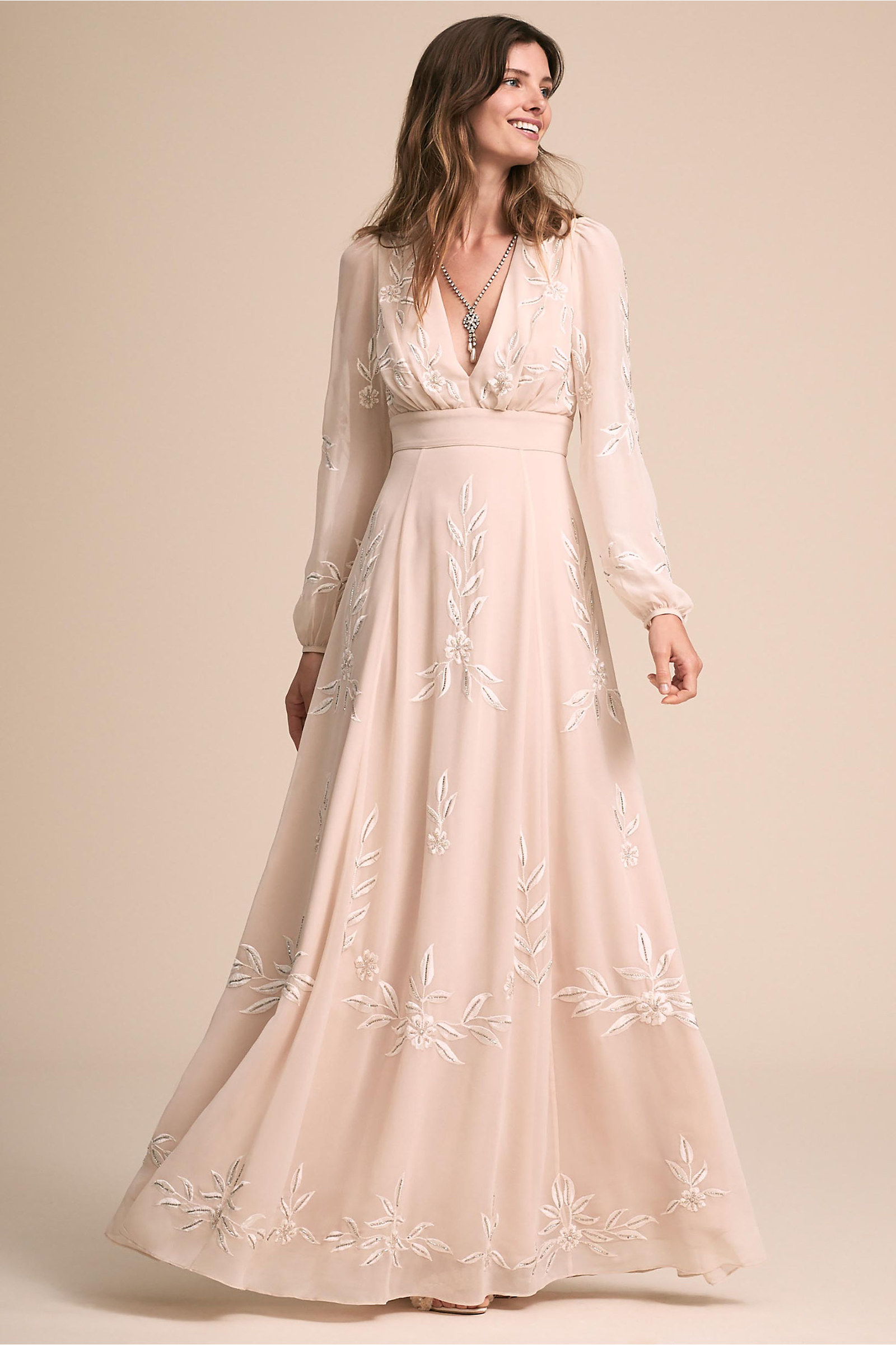 12f5157c An embroidered gown that would make for a flawless beach wedding look. Yes, you  can even wear sleeves in the sand!