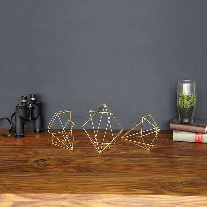 the gold wire decor on a table