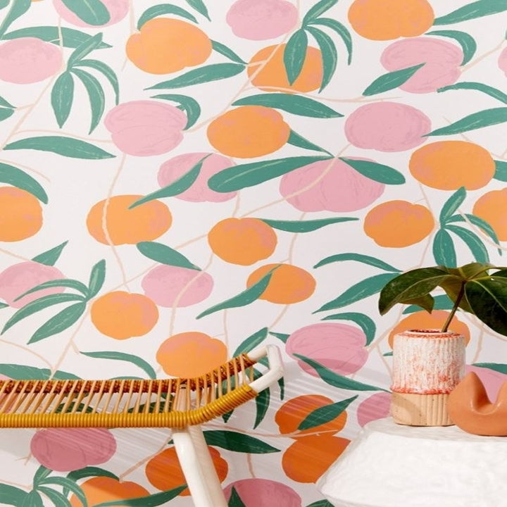 the peach printed wallpaper in a room