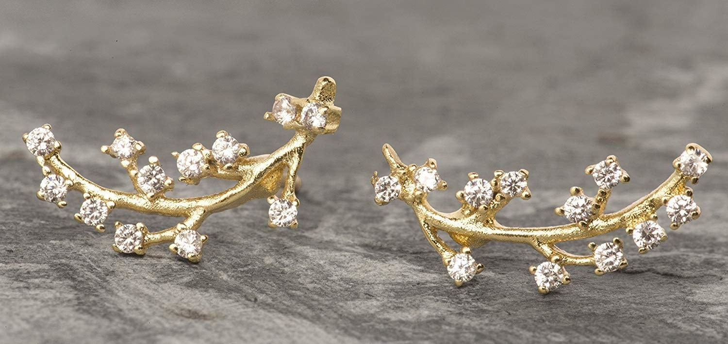 The branch-like earrings with rhinestones on the end of each prong
