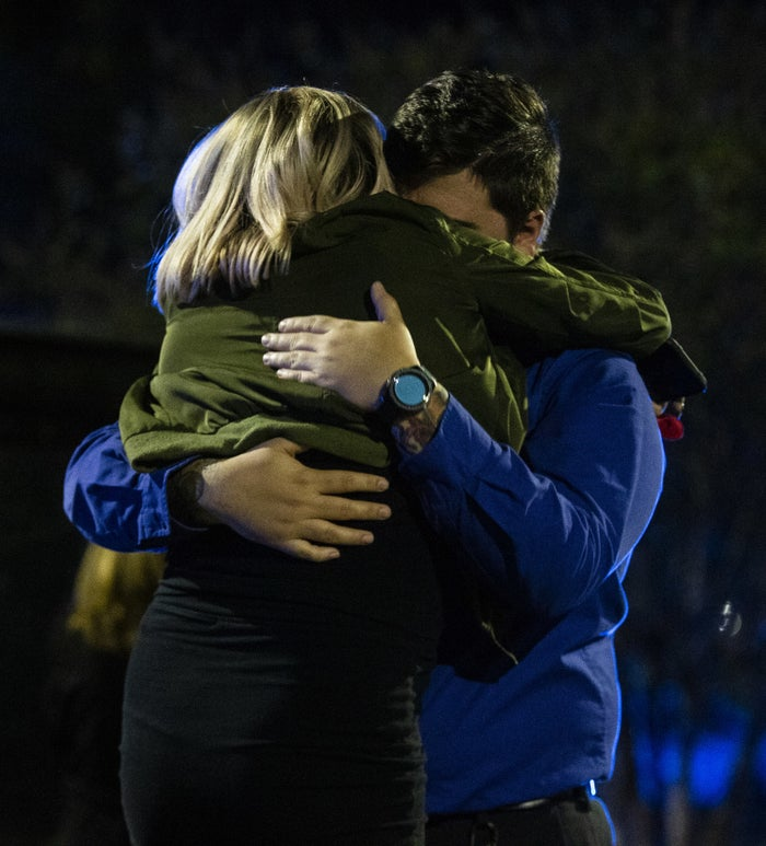 Nick Cessna comforts his girlfriend Melissa Hutchinson, who rendered aid to some of the victims.