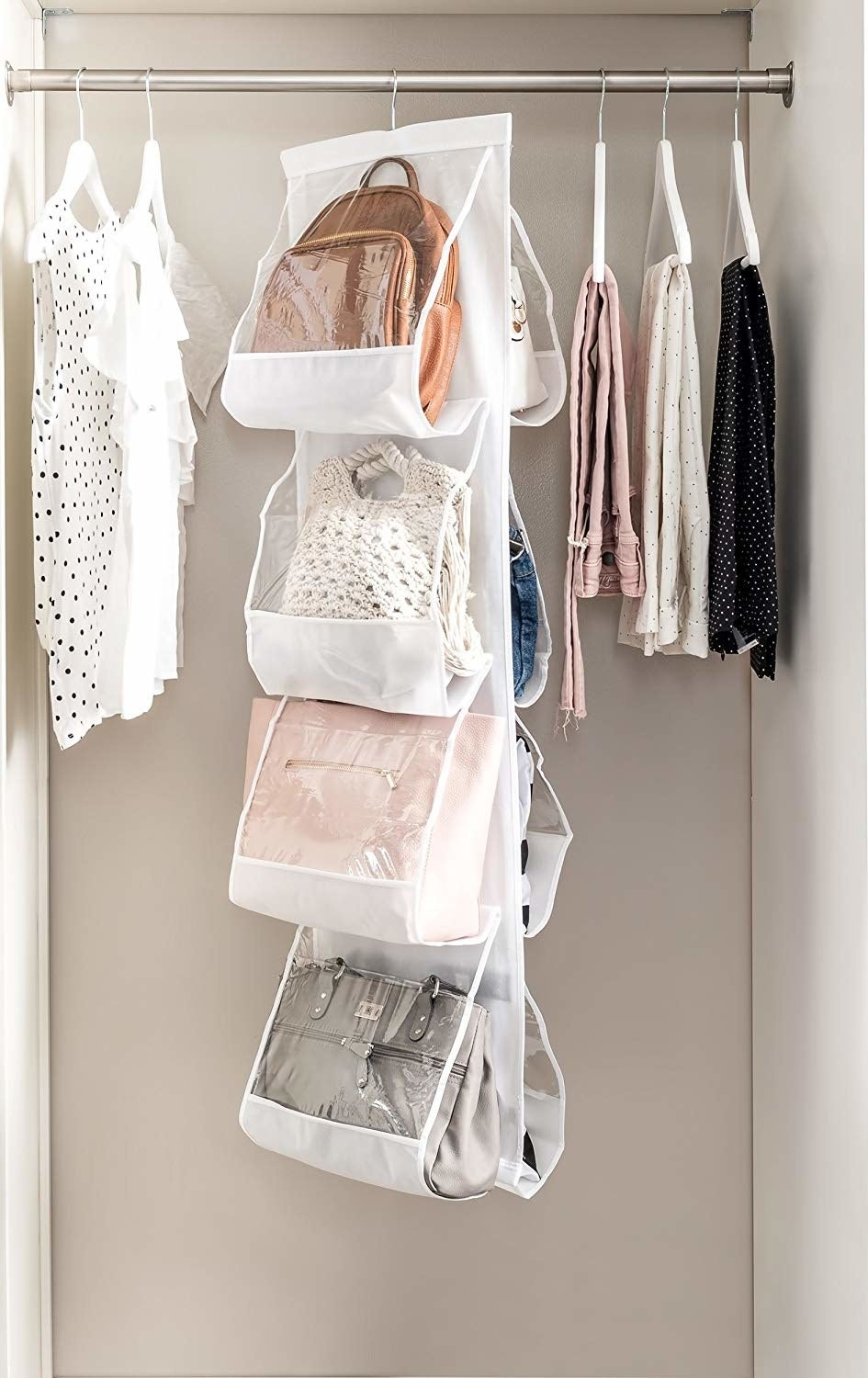vertical purse organizer hanging in the closet
