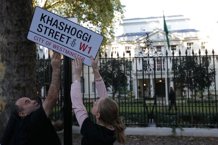 A mock street sign is erected by Amnesty International activists on the street in front of the embassy of Saudi Arabia in London on Nov. 2.
