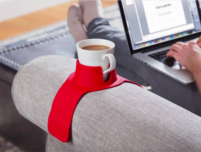 227977025af4 A weighted drink holder that ll grip onto your beverage while you re taking  care of very important business