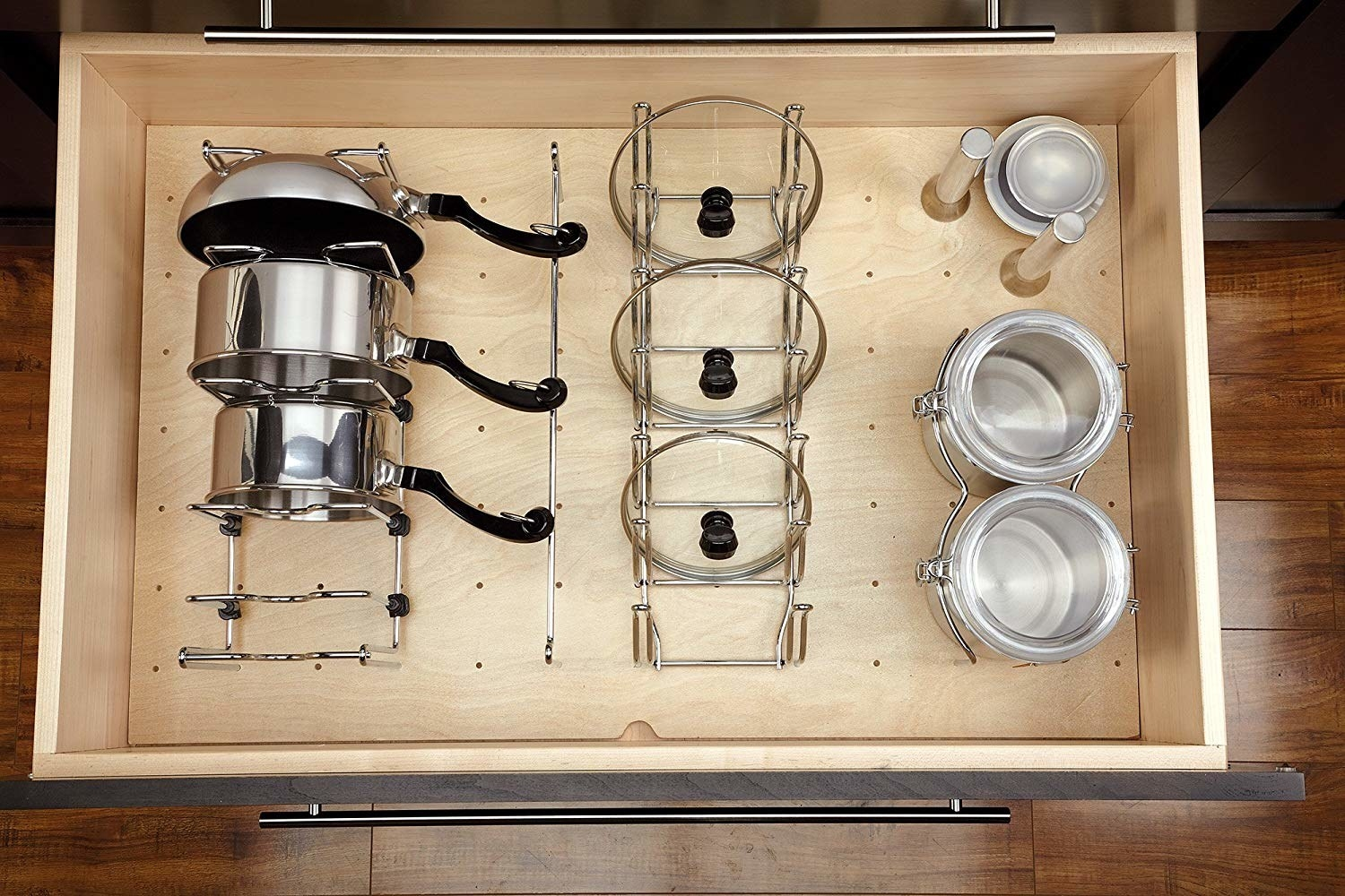 open kitchen drawer with a peg board bottom and adjustable organizers to hold pans and lids