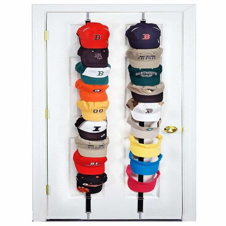 Baseball caps clearly lined up on the holder