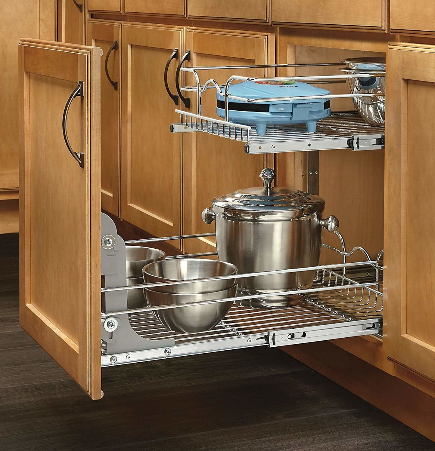 kitchen cabinet door attached to roll-out two-tier shelf with small appliances on it