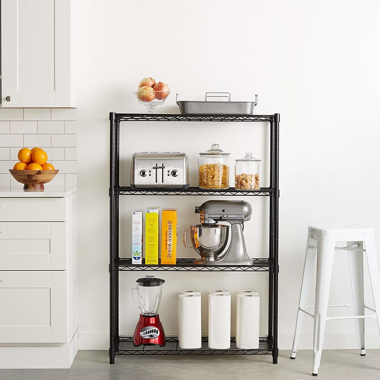 the shelves in black holding a blender, a stand mixer, a toaster, cereals, jars, and other items