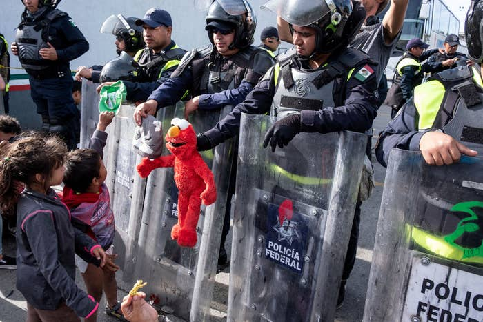 Children play with Mexico's Federal Police at the El Chaparral port of entry on the US–Mexico border in Tijuana, Mexico, on Nov. 22.