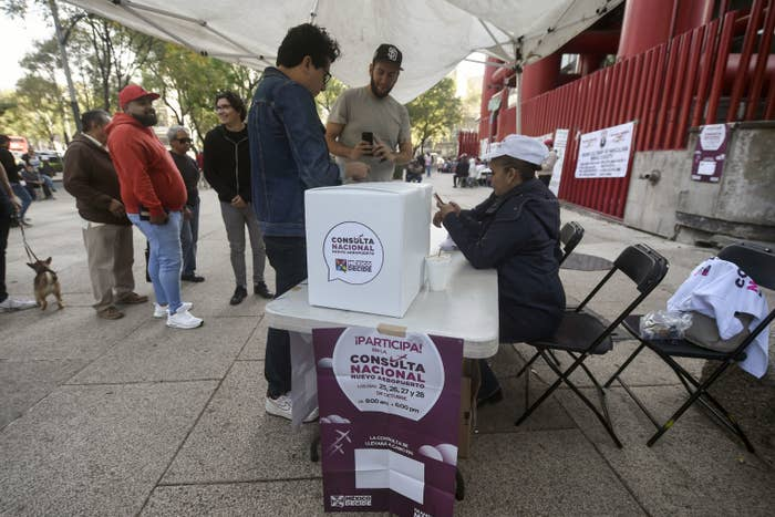 Mexicans line up to vote during a referendum on the construction of a new airport in Mexico City.
