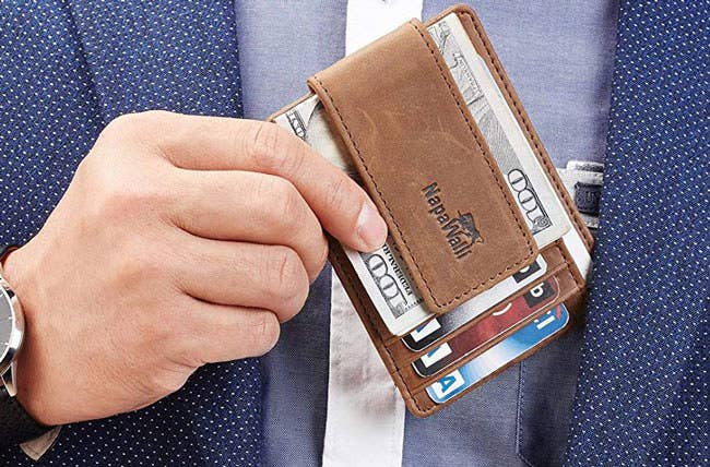 """Promising review: """"I absolutely love this new wallet. It is way thinner than a traditional bifold and holds all my cards. The magnetic money clip is super strong. And I have had no issues with anything coming loose."""" —Brycen MPrice: $15.99 (available in eight colors)"""