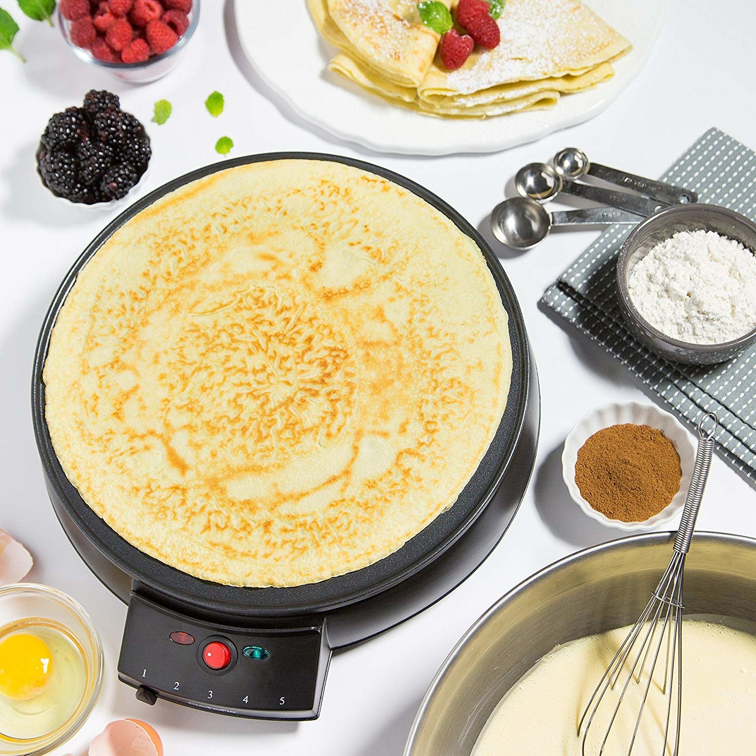 A crepe cooking on the crepe maker