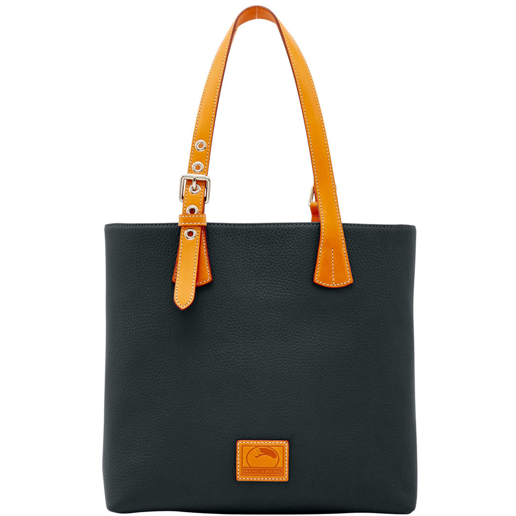 A Classic And Splurgeworthy Leather Tote Bag So Your Sister Can Carry Around All Of Her Essentials Whether Shes Headed To Work Or Out Dinner With
