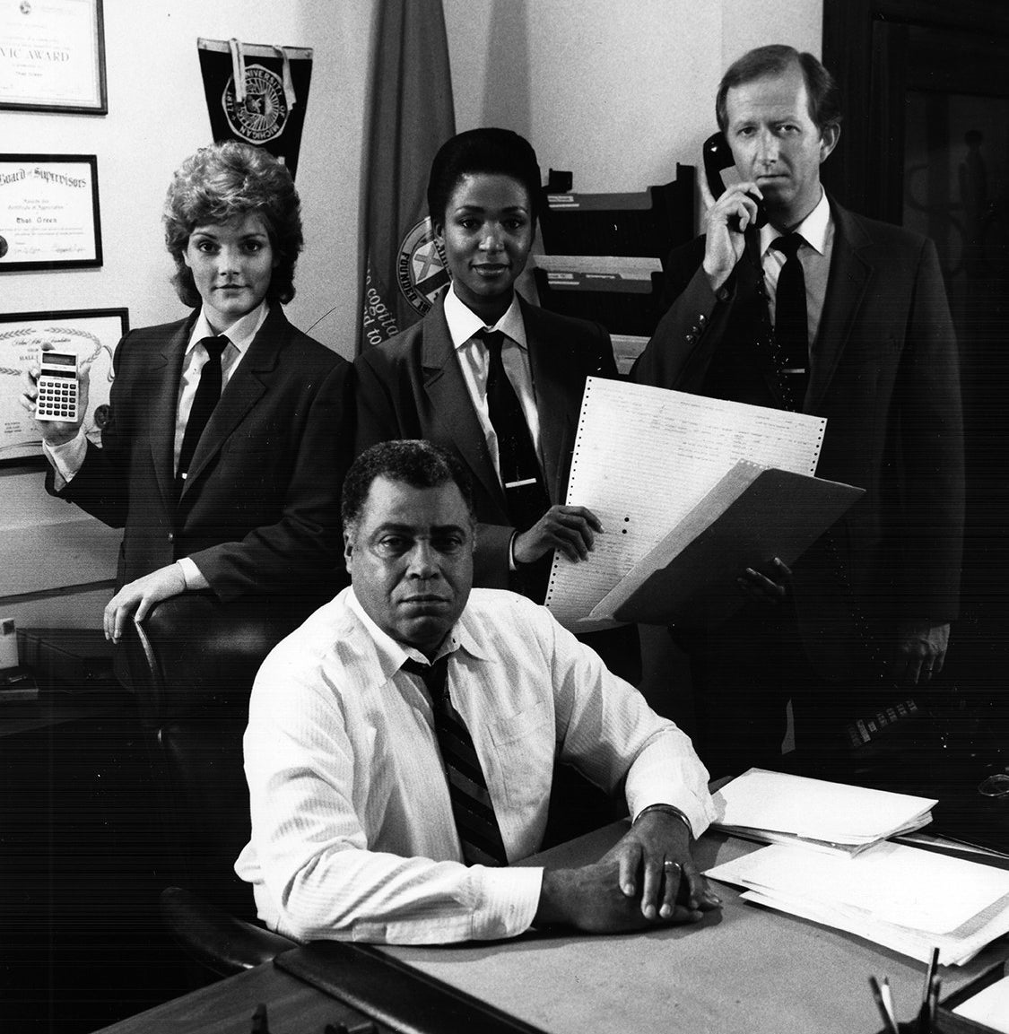 The Mathnet team (clockwise from top left): Detective Kate Monday (Beverly Leech), Technical Analyst Debbie Williams (Mary Watson), Detective George Frankly (Joe Howard) and Chief Thad Green (James Earl Jones).