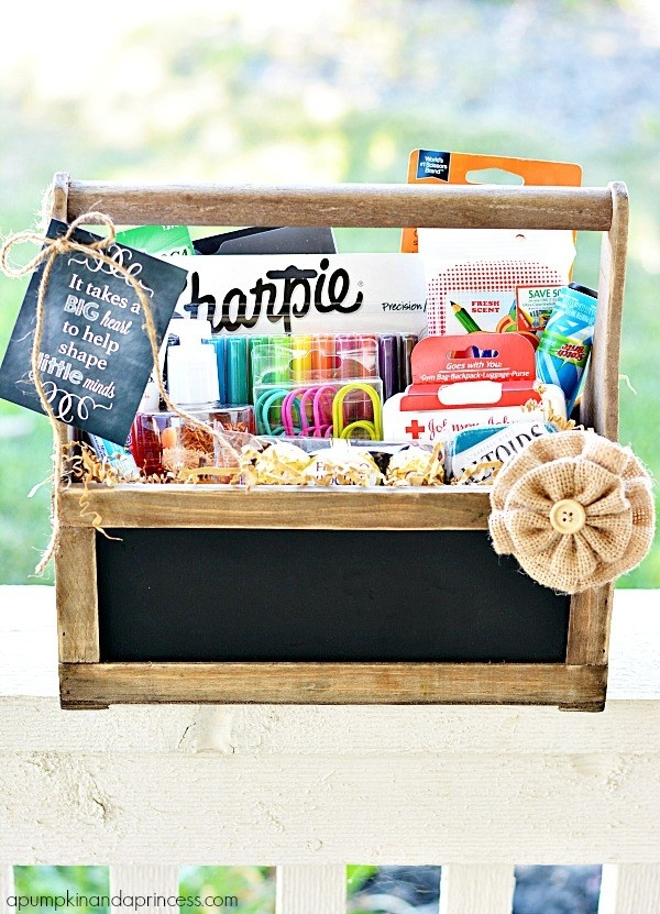 chalkboard-front basket filled with craft, school, and cleaning supplies
