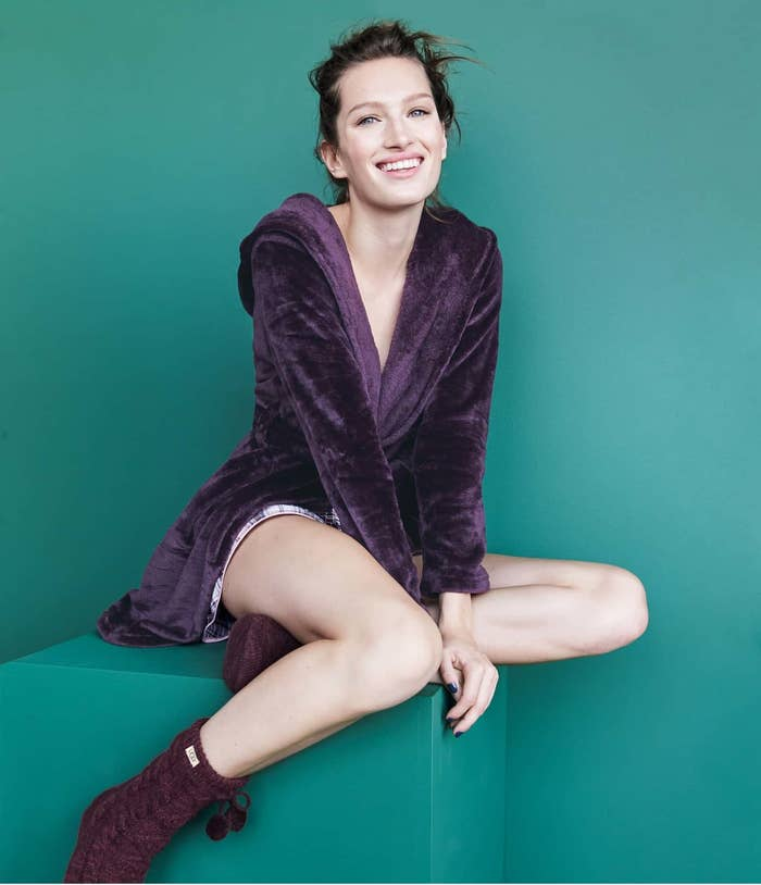 Model wearing the velvet fuzzy knee-length robe in dark purple