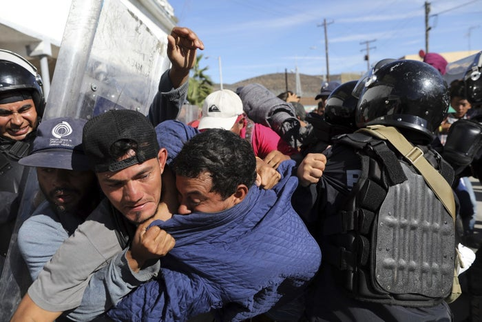 Migrants clash with Mexican police at the Mexico–US border on Nov. 25.