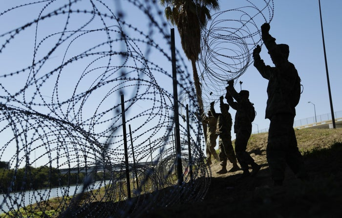 US military troops install concertina wire along the banks of the Rio Grande in Laredo, Texas.