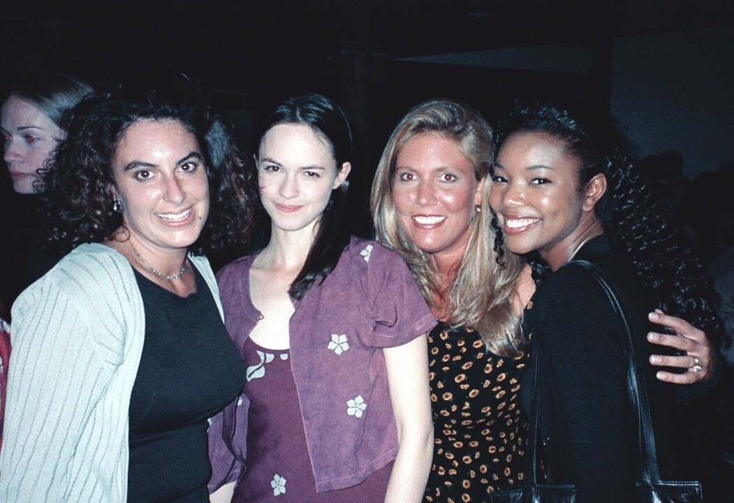"Karen Smith and Kirsten ""Kiwi"" McCullah with 10 Things I Hate About You stars Susan May Pratt and Gabrielle Union."