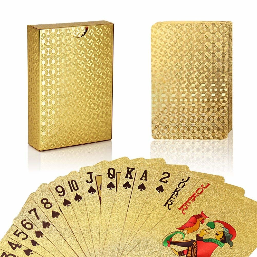 The gold patterned playing cards