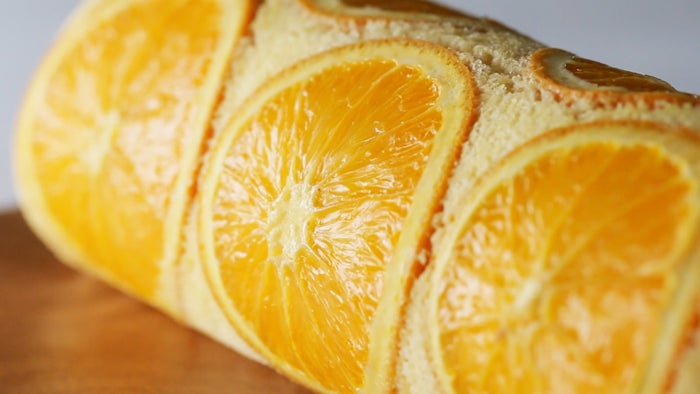 Orange Swiss Roll CakeServings: 4INGREDIENTS3 medium eggs, separated100 grams granulated sugar, divided50 milliliters milk50 milliliters vegetable oil70 grams all-purpose flour5 medium orange slices200 milliliters heavy cream1 medium orange, peeled and cut into segmentsPREPARATIONPreheat the oven to 350˚F (180˚C). Line a 9-inch square baking dish with parchment paper.In a medium bowl, beat the egg whites with an electric hand mixer on medium speed until foamy. Add 50 grams of granulated sugar in 2 additions, and beat until medium peaks form. In a separate medium bowl, add the egg yolks and 30 grams of granulated sugar and beat with an electric hand mixer until pale. Add the milk and oil and whisk to combine, then sift in the flour and stir until well-combined. Add ⅔ of the whipped egg whites and gently fold until combined. Add the rest of the egg whites and fold to combine. Arrange the orange slices in the center of the prepared baking dish, then pour the batter on top. Spread evenly with a spatula.Bake for 15 minutes until cooked. Let cool to room temperature. Remove the cake from the pan using the parchment paper.In a medium bowl, beat the heavy cream and remaining 20 grams of granulated sugar with an electric hand mixer until soft peaks form. Spread the whipped cream evenly over the cooled cake. Arrange the orange segments in 2 lines at the bottom center of the cake. Starting from the bottom, gently roll into a log.Chill in the fridge for at least 1 hour, then slice and serve.Enjoy!