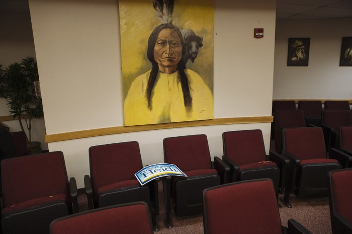 A campaign sign for Sen. Heidi Heitkamp is left behind under a portrait of Sitting Bull at the Standing Rock Sioux tribal headquarters.