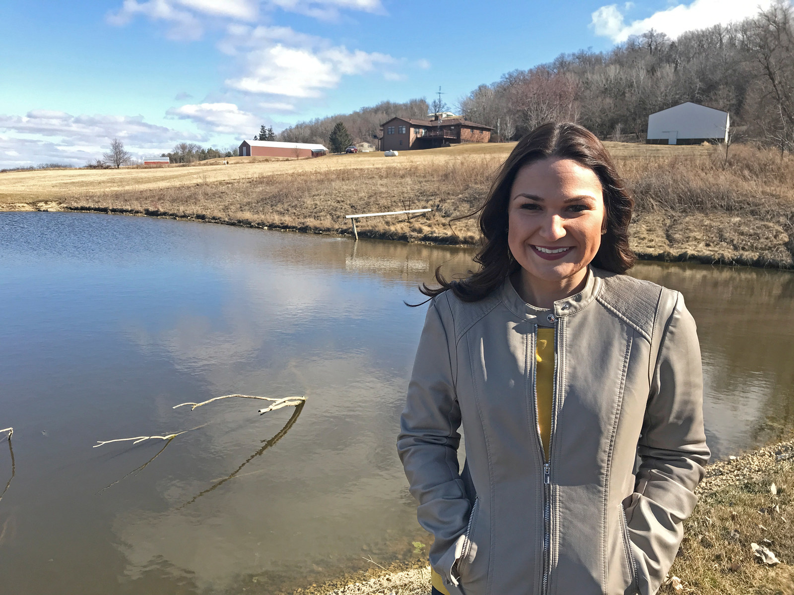 Abby Finkenauer is pictured on the grounds of the house in which she grew up in Sherril, Iowa, March 31, 2018.