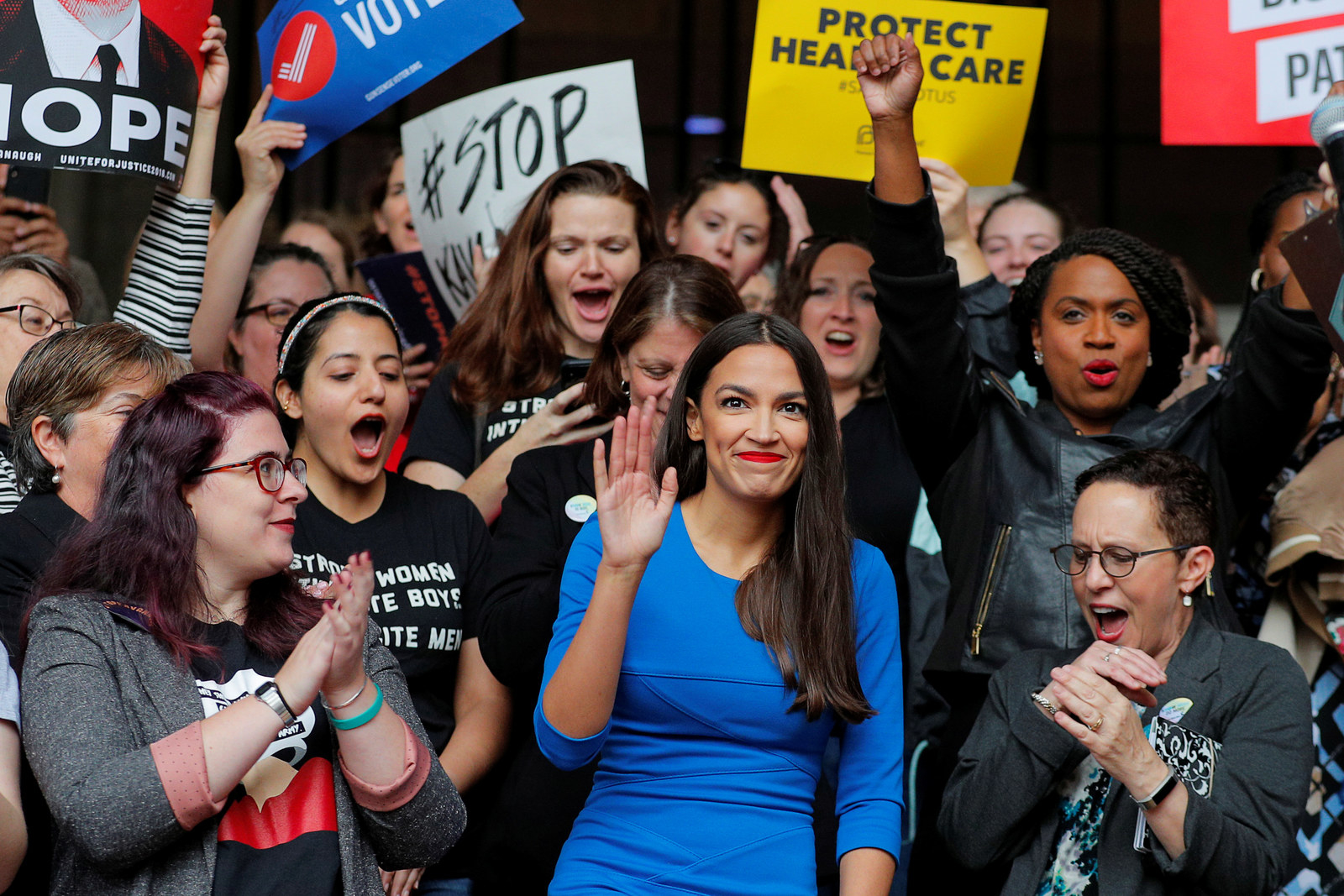 Democratic Congressional candidate Alexandria Ocasio-Cortez is introduced to speak at a really against Supreme Court nominee Brett Kavanaugh in Boston, Oct. 1, 2018.
