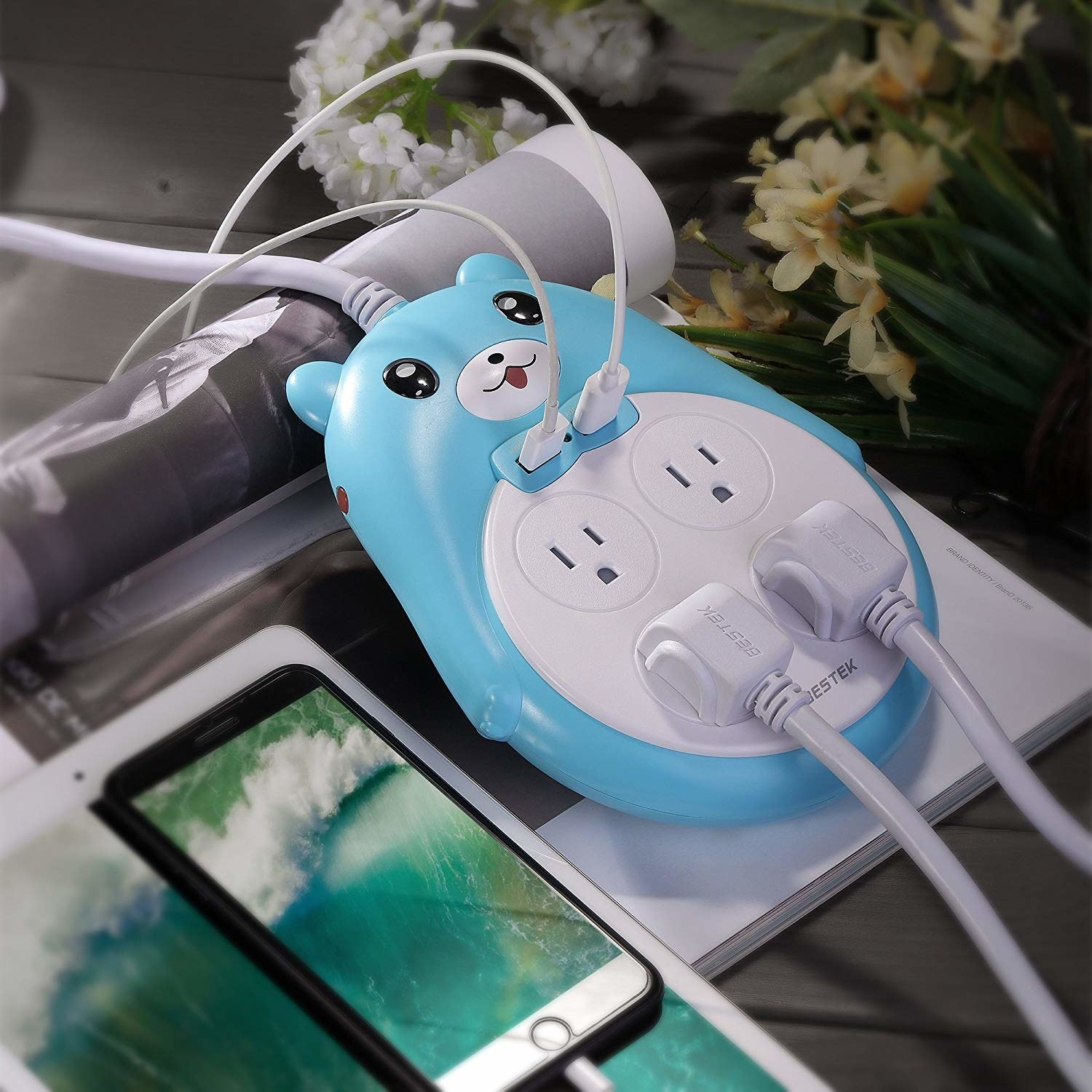 blue bear with four outlets and to USB outlets