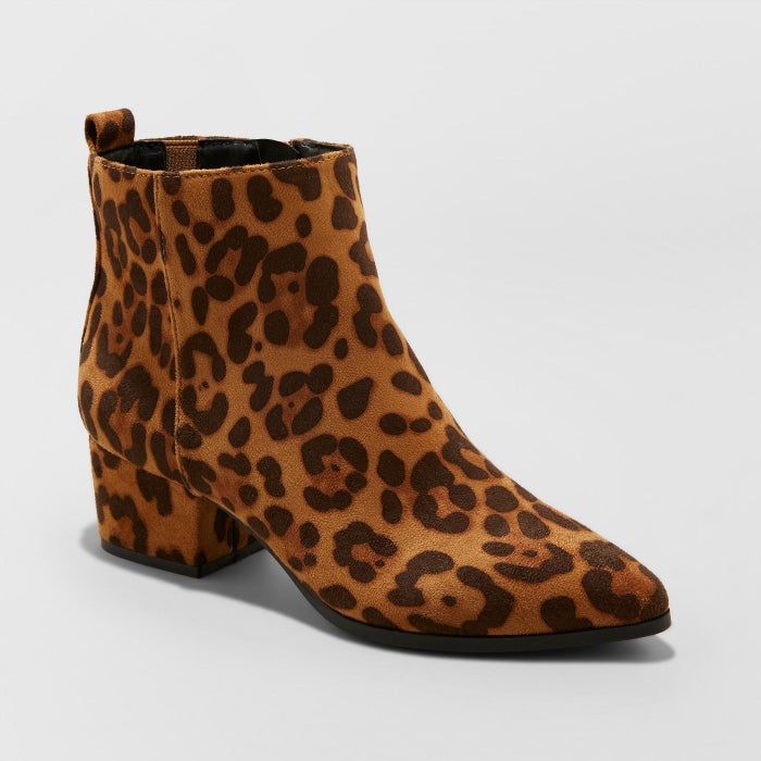 """Promising review: """"I saw these and had to have them. They're super cute and comfy, and the material is micro suede and doesn't look cheap. It's a great ankle height."""" —PerryFGet them from Target for $34.99 (available in sizes 5-12 and in black, white, and leopard)."""