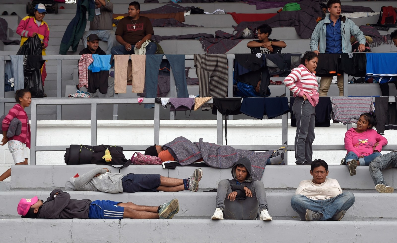 Migrants at a sports complex in Mexico City.