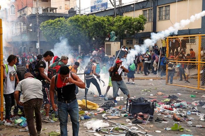 Central Americans encountered tear gas in Tecun Uman, Guatemala.