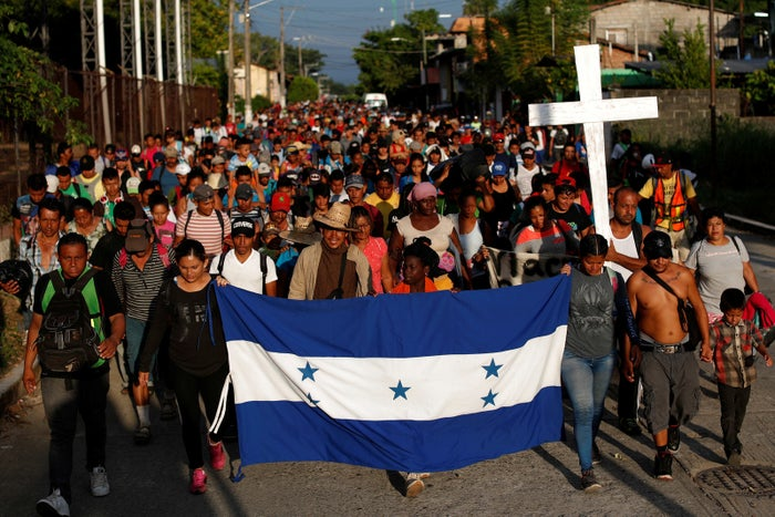 Migrants carry a Honduras flag in Pijijiapan, Mexico.