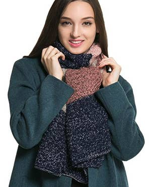 fef2120ece18f A thick cable scarf that you can pair with either your heavy coat or a  simple sweater to stay snug as a bug all day.