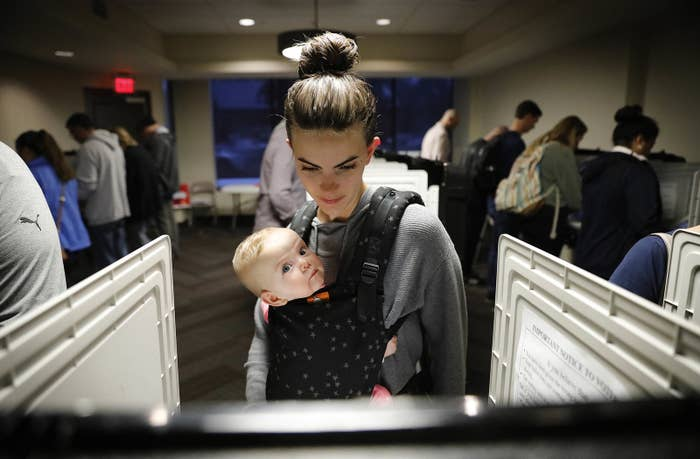 Kristen Leach votes with her 6-month-old daughter, Nora.