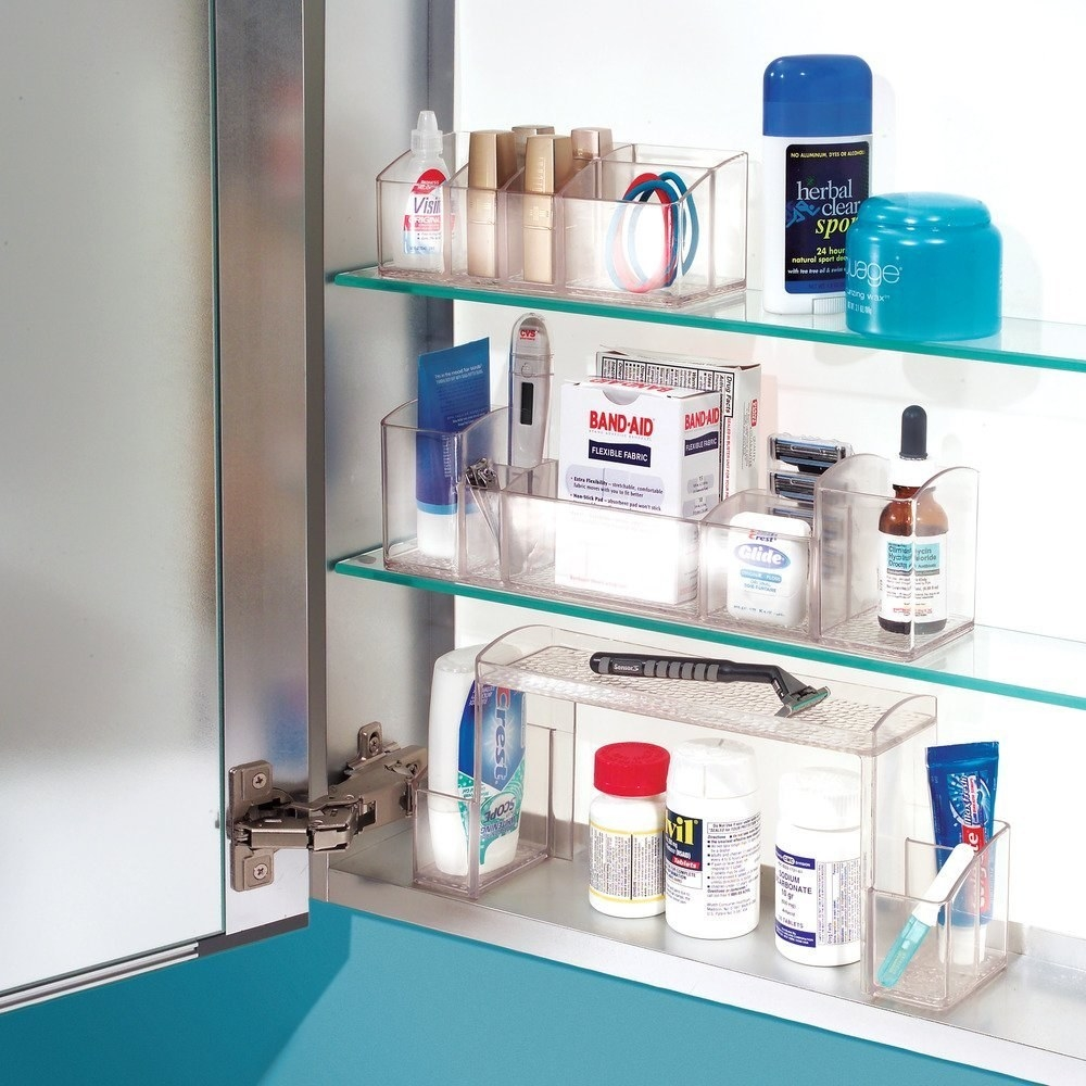 inside a medicine cabinet with clear plastic organizers