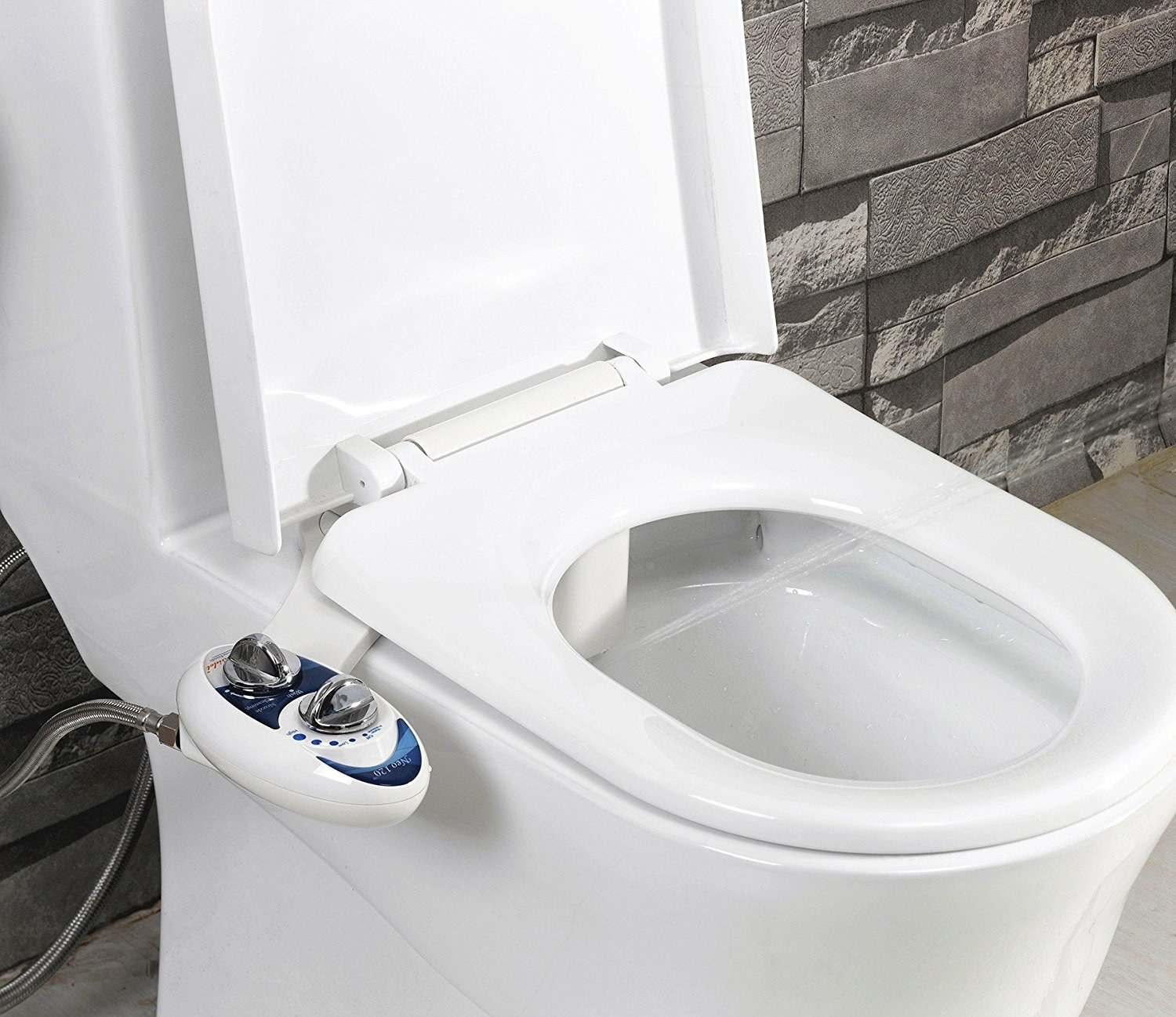 toilet with a bidet attachment on it