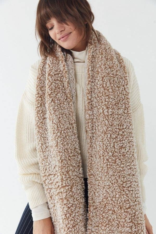28cba3252f010 This teddy bear scarf that will make you feel like you're still snuggled up  in bed despite the fact you're out running errands.