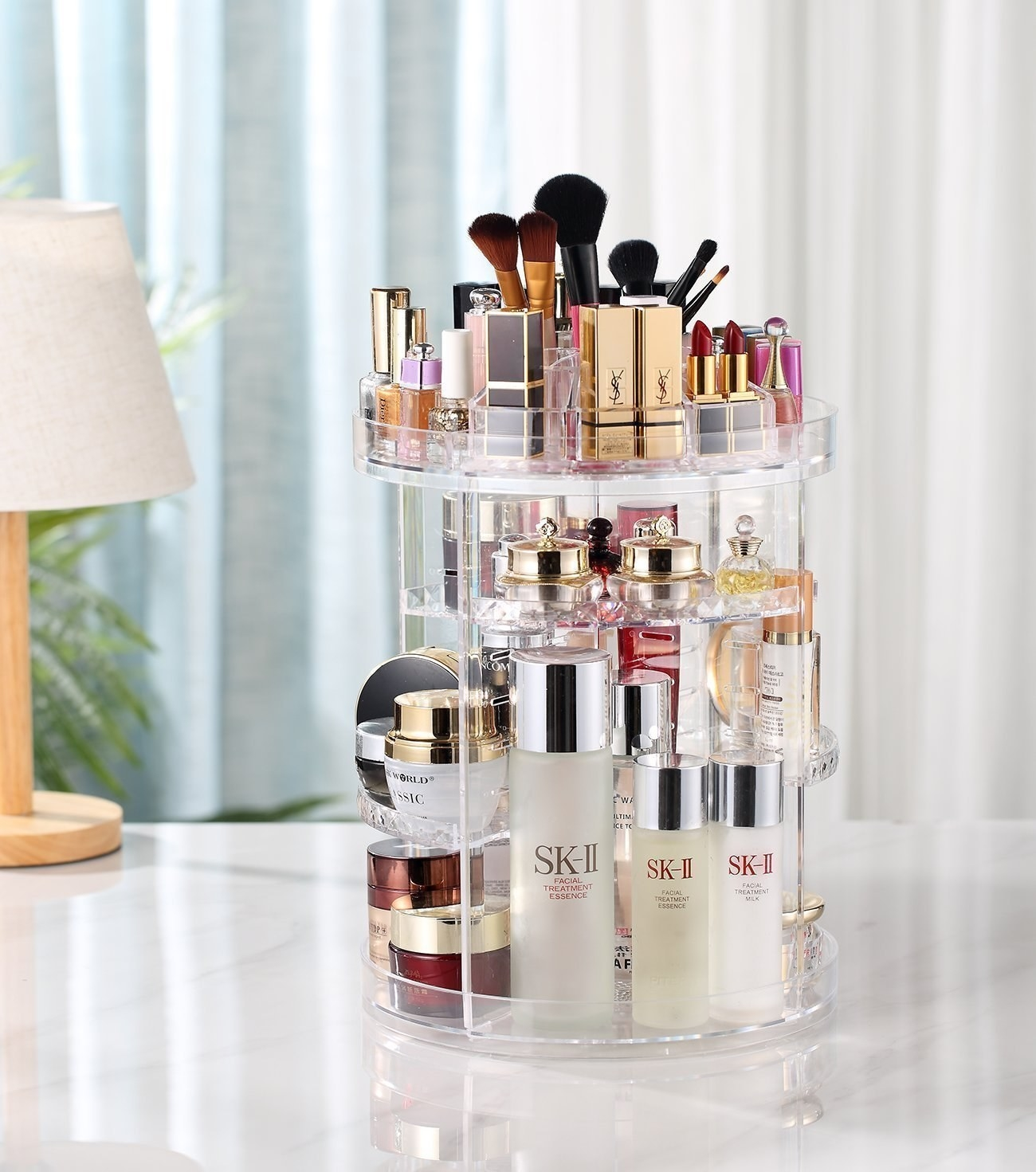 tall cylinder shape organier with makeup and skin products shelved on it