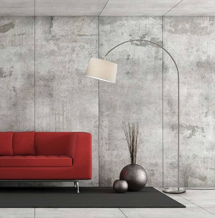This arch lamp has a weighted base, so you don't need to worry about stability. Price: $115 (available in two finishes)