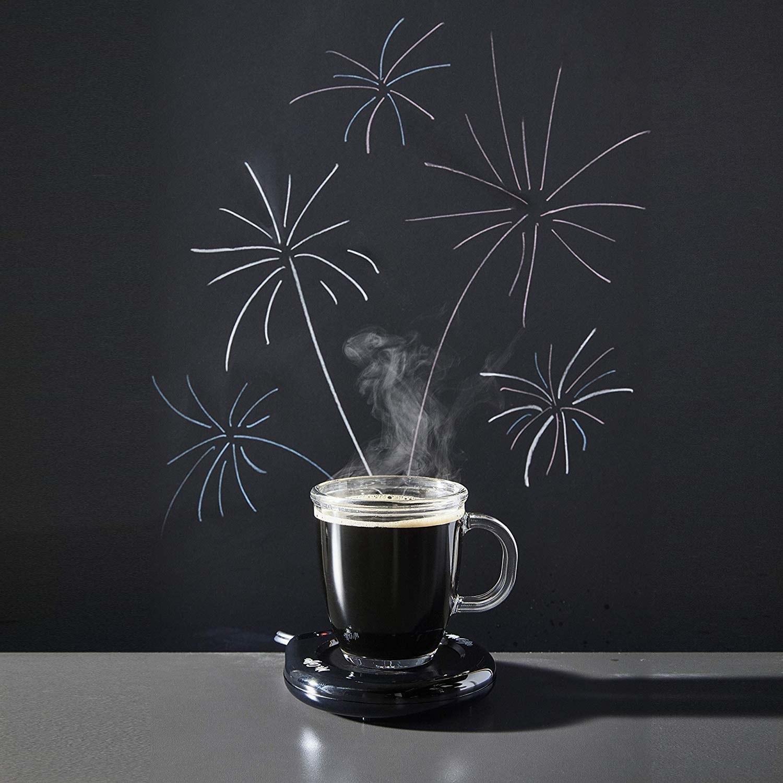 cup on dish-shaped mug warmer