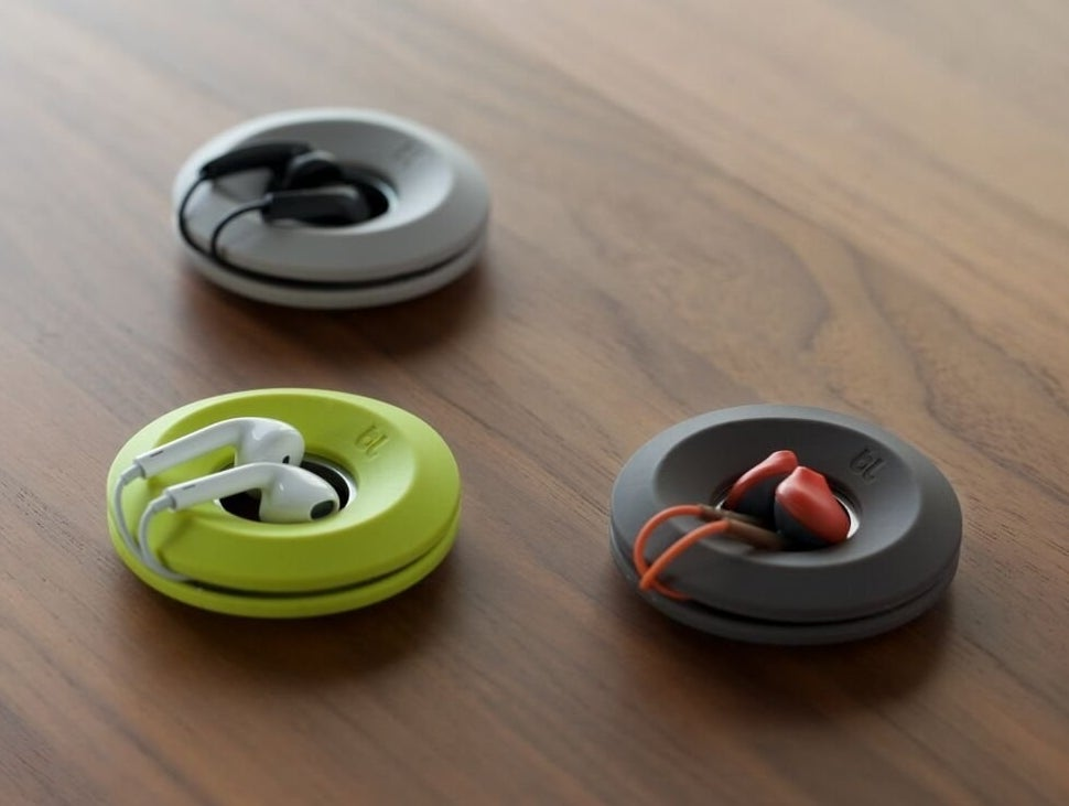 three different colored ear bud detanglers in-use
