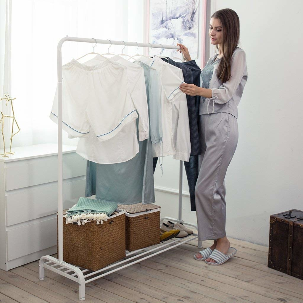 a model going through clothes on the rack